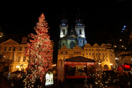 at town square: Old Town Square in Prague with Tyn Cathedral during the Christmas celebrations at night Stock Photo