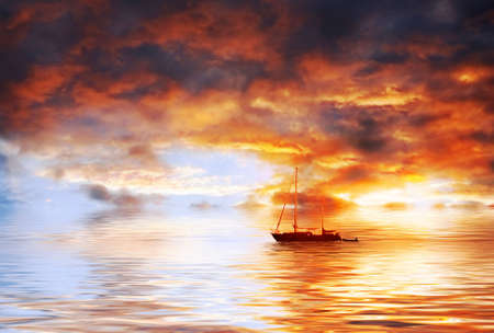 Fantastic sunset over the ocean with the ship Stock Photo - 4147131