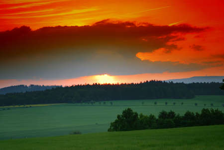 Beautiful landscape with green field and setting sun Stock Photo - 4458590