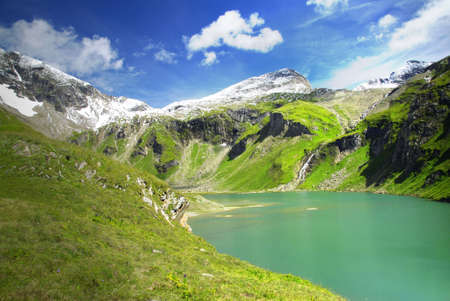 Alpine peaks covered by snow and a beautiful crystal clear lake Stock Photo - 4458698