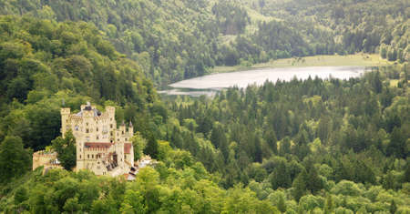 allgau: Famous German castle Hohenschwangau in the mountains with a lake in the back  Stock Photo
