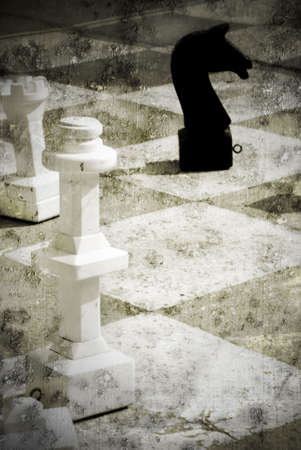 Grungy chessboard with a white king and a black horse with a strong grungy touch Stock Photo - 4458693