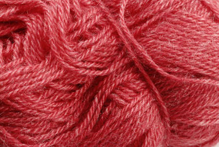 Detail of a red knitting skein- fabric background photo