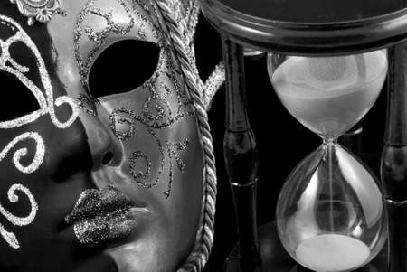 noir: Venetian mask and hourglass in black and white