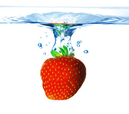 Fresh red strawberry in the blue water with splash