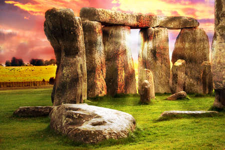 druid: Fantasy sunrise at Stonehenge with dramatic sky and sun rays