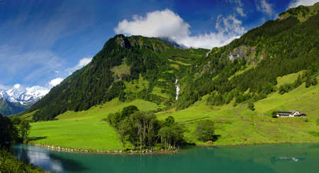 View at alpine mountain peaks from the mountain lake. Panoramic photo Stock Photo - 5814034