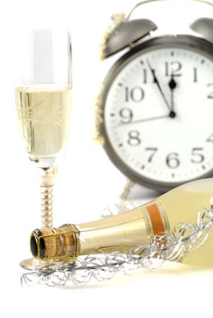 Happy new year background with champagne and Alarm clock photo