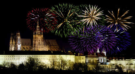 prague castle: Prague castle in the night - residence of czech president and colorful fireworks during the New Year celebrations