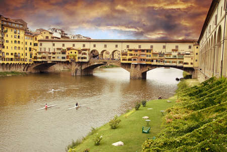 oldest: Beautiful sunset over of the oldest bridge over the river Arno in Florence Ponte Vecchio