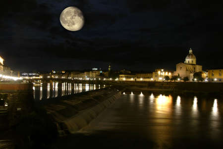 Beautiful Italian city Florence, Italy at night with moon and river Arno Stock Photo - 6227406