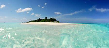 lagoon: Beautiful Maldivian atoll with white beach seen from the sea.Panorama