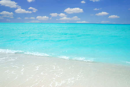 Beautiful crystal clear Maldivian sea and a blue sky with clouds photo