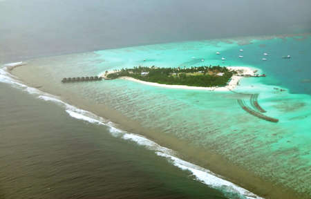 Beautiful Maldivian atoll seen from the flying airplane  photo