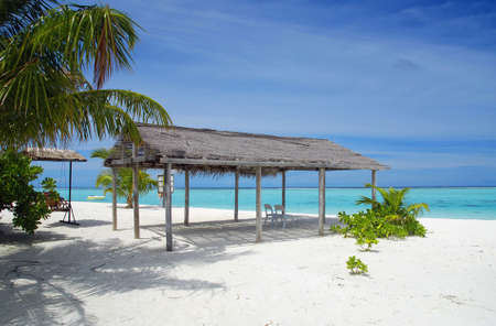 Beautiful tropical beach with turquoise sea, white sand, palm and shack
