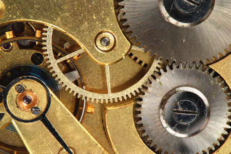 Mechanism of old clock - sprockets in the system are well visible photo