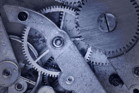 the ancient pass: Mechanism of old clock - sprockets in the system are well visible, blue tint
