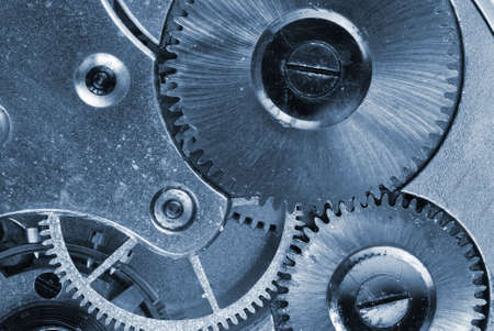 Mechanism of old clock - sprockets in the system are well visible, blue tint Stock Photo - 6850382