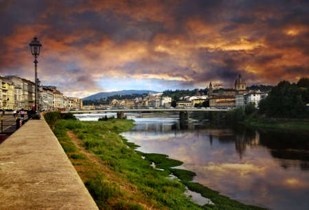 arno: Dramatic sunset over the river Arno in Florence, Italy