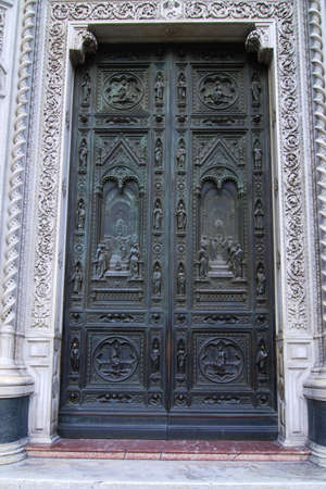 Beautiful renaissance bronze door of the cathedral Santa Maria del Fiore in Florence, Italy Stock Photo - 6984021
