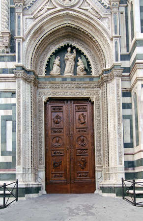 firenze: Beautiful renaissance wooden door of the cathedral Santa Maria del Fiore in Florence, Italy