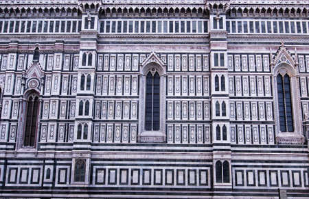 Beautiful renaissance wall of the cathedral Santa Maria del Fiore in Florence, Italy photo
