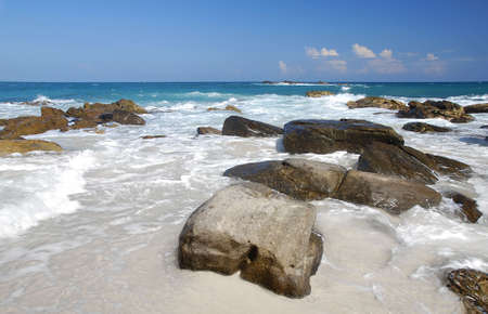 Wild tropical sea background with boulders facing the ocean Stock Photo - 7427024