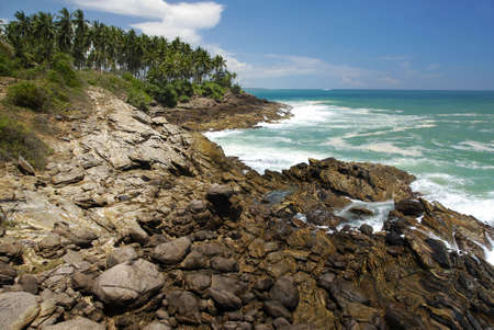 tangalla: Beautiful and wild scenery of Sri Lankan cliffs washed by sea surf Stock Photo