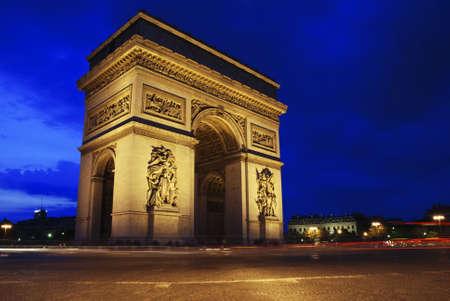 Beautifly lit Triumph Arch at night. Paris, France.  photo