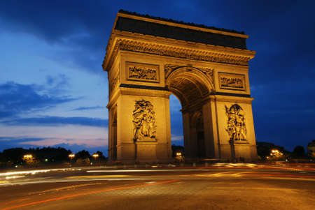 Beautifly lit Triumph Arch at night. Paris, France.  Stock Photo