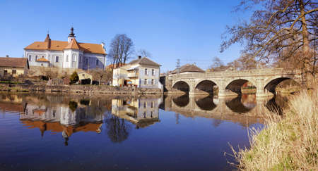 Small town of Mirovice in the Southern Czech Republic at dusk time. Old Bridge over the river Skalice and local church are well visible on this panorama Stock Photo - 8678850