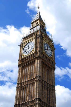against the clock: Famous British clock tower Big Ben against the blue sky