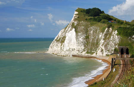 dover: Beautiful white cliffs near Dover, UK and railway
