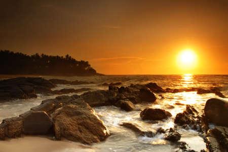 Beautiful colorful sunset over sea and boulders on Sri Lanka Stock Photo - 8848703