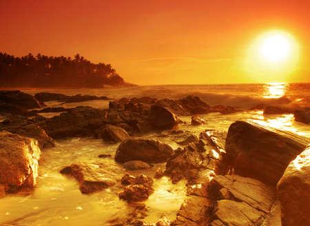 Beautiful colorful sunset over sea and boulders on Sri Lanka Stock Photo - 8848700