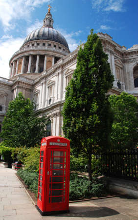 Saint Pauls Cathedral and a red telephone booth in front of it photo