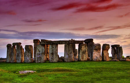 Historical monument Stonehenge not far from town of Amesbury at sunset, England. HDR Stock Photo