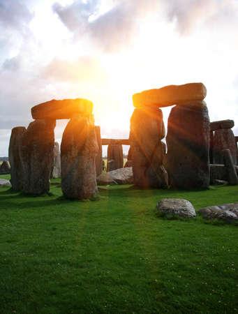 stonehenge: Fantasy sunrise at Stonehenge with dramatic sky and sun rays