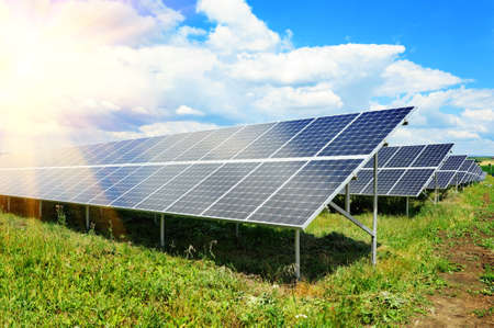 Solar panel produces green, enviromentaly friendly energy from the sun.  photo