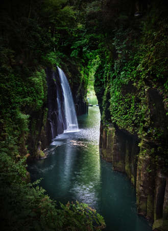 meander: Beautiful gorge Takachiho with a blue river and waterfall, Japan - Kyushu island
