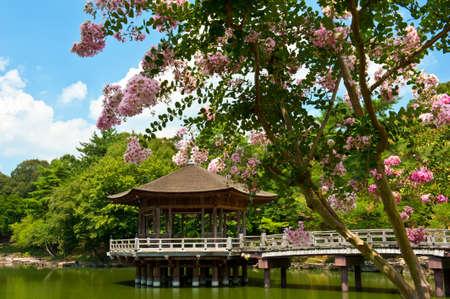 Beautiful wooden gazebo over the lake in Nara city, Japan. photo