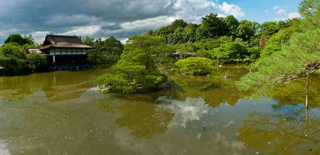 Beautiful Japanese Garden near Heian Shrine is reflecting in the calm water. photo