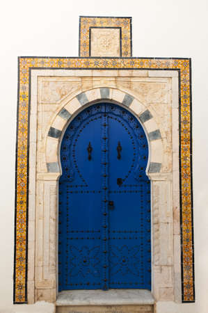 arabic architecture: Beautiful ornamental blue door of so typical shape for Tunisia