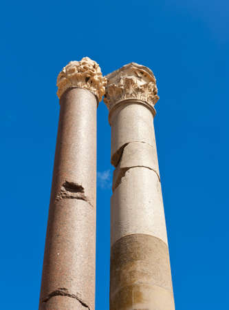 Two ancient roman pillars against a blue sky photo