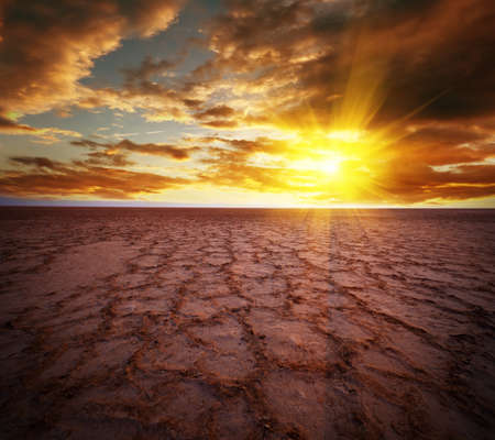 sahara: Beautiful dramatic sunrise over great dried-up salt lake Chott el Djerid in Tunisia