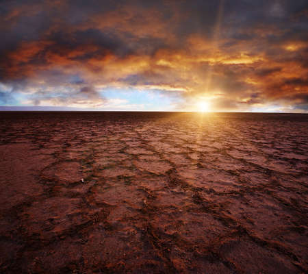 Beautiful dramatic sunrise over great dried-up salt lake Chott el Djerid in Tunisia photo