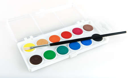 Set of watercolor paints with a brush photo