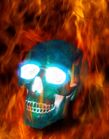 Magic transparent ice skull burning in terrible flames photo