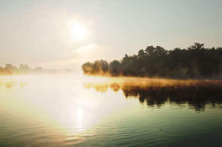 rhein: River Rhine in Switzerland is reflecting morning sun rays to the haze Stock Photo