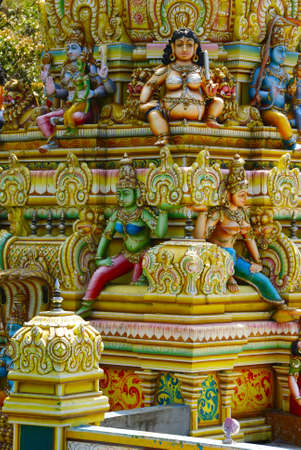 Detail of a beautiful vivid hindu temple with statues of deity photo